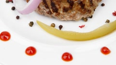 Hot beef meat hamburger dinner on white plate Stock Footage