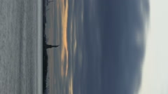 Vertical shot of Statue Of Liberty seen from across the bay Stock Footage