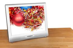 Christmas still life with red ball on screen of TV - stock photo