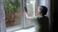 Woman changes position window opening Stock Footage