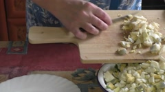 A woman prepares filling for pies eggs and green onions Stock Footage