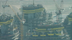 Aerial construction cranes high elevation Dubai UAE - stock footage
