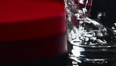Slow motion water pouring with swirls and bubbles Stock Footage