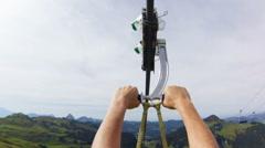 Woman ziplining down a mountain. Stock Footage