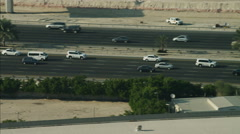 Aerial Dubai Road commuter traffic multi lane desert UAE - stock footage