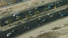 Aerial Dubai Road commuter traffic Highway desert UAE Stock Footage