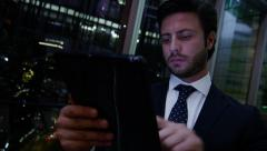Caucasian European male business advisor night hotel travel technology tablet - stock footage