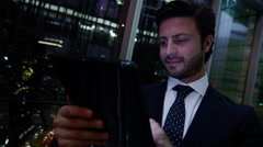 Arabic business man UAE real estate construction night office technology tablet - stock footage