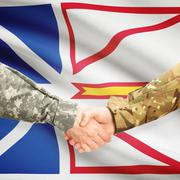 Military handshake and Canadian province flag - Newfoundland and Labrador - stock photo