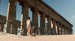 Tourist girl visiting Segesta Greek temple in Sicily, Italy Stock Footage
