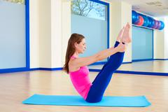Pilates woman open leg rocker exercise workout - stock photo
