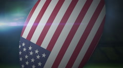 USA rugby ball in stadium with flashing lights Stock Footage
