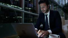 Middle Eastern male office night business insurance oil growth laptop computer Stock Footage