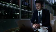 portrait Middle Eastern male office night business insurance oil growth laptop - stock footage