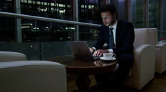business laptop technology commodities stocks shares Arabic male trading night - stock footage