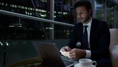 Caucasian European male business advisor night hotel travel laptop smart phone - stock footage