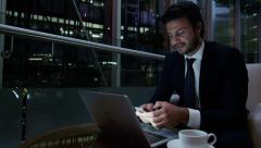 Caucasian European business male night traveller technology smart phone laptop - stock footage
