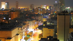 Panning shot of Tel Aviv time-lapse of the city at sunrise. - stock footage