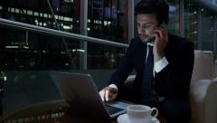 Caucasian European male business advisor night hotel travel laptop smart phone - stock footage