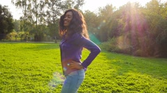 Happy african girl have fun in sunny park laughing, fooling, slow motion. Stock Footage