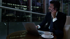 Middle Eastern man office night business insurance oil growth smart phone laptop - stock footage