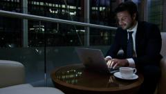 Arabic business man UAE real estate construction night office technology laptop - stock footage