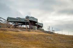 Abandoned cablecar station used for coal transportation, Svalbard - stock photo