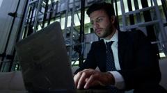 Male Western European business technology laptop finance banking night hotel Stock Footage