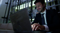 Middle Eastern male office night business insurance oil growth laptop computer - stock footage
