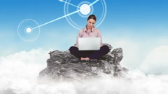 Businesswoman using laptop in the clouds Stock Footage