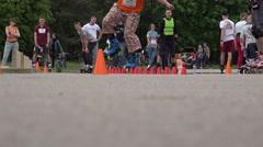 Man perform onefoot slalom element in roller skater festival . 4K Stock Footage