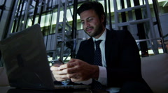 male Western European business laptop smart phone finance banking night hotel - stock footage