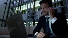 Male Western European business laptop smart phone finance banking night hotel Stock Footage