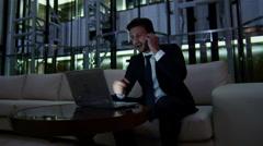 Arabic business man UAE real estate night office technology laptop smart phone - stock footage