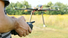 Pilot's hands with  radio transmitter,  operate of drone.4K 3840x2160 - stock footage