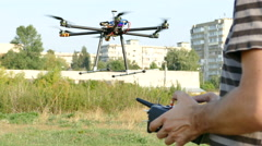 Pilot's hands with  radio transmitter,  operate of drone with eight propeller Stock Footage