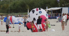 A car you can`t ride - kids are usind an air seimmer lying on the sand as a Stock Footage