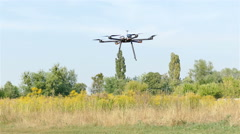 Drone fly and landing on grass   .4K 3840x2160 Stock Footage