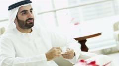 UAE Arabic businessman male beard office coffee economy property insurance - stock footage