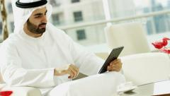 Male Arab real estate business executive national dress office tablet technology Stock Footage