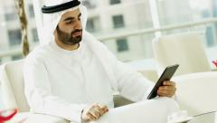 Emirati business man Dubai financial growth insurance technology wireless tablet - stock footage