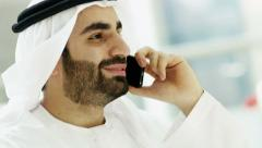 Emirati businessman insurance Dubai financial growth smart phone technology - stock footage