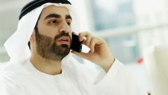 male Emirati business wealth Dubai city consultant smart phone technology - stock footage