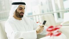Emirati businessman business male Dubai financial growth smart phone technology - stock footage
