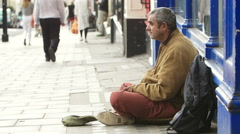 Homeless man living on the street Stock Footage