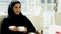 Arabic female traditional dress social lifestyle hotel coffee hospitality Stock Footage