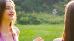 Friends, young girls, caucasians, talking outdoors, ots. Stock Footage