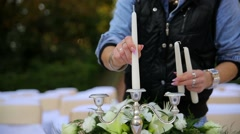 putting candles in the candlestick - stock footage