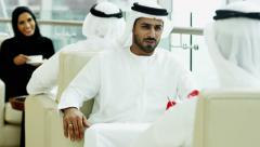 Emirati male female business colleagues meeting coffee oil commodity economy - stock footage