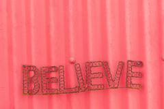 Believe Words  Sign Red Wall Stock Photos